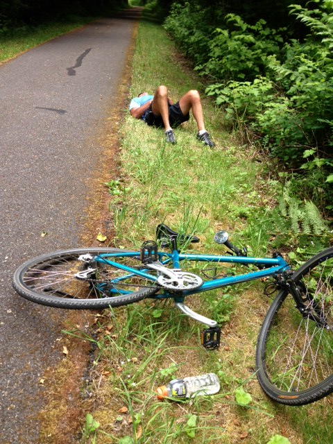 He landed more than 12 feet from his downed bike and rolled off the asphalt
