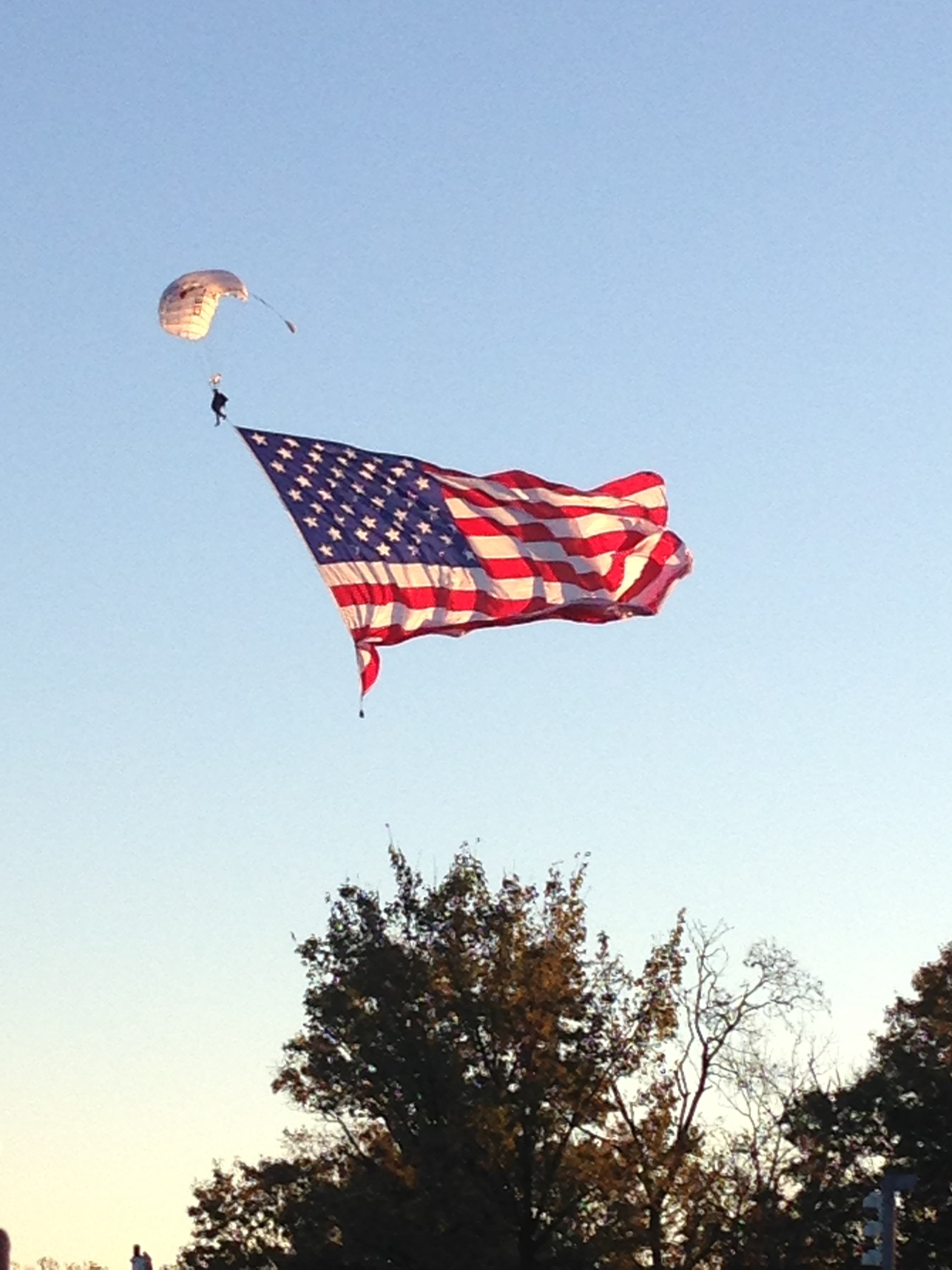 One of many paratroopers displaying the flag
